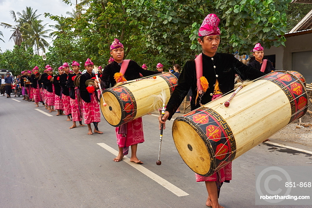 Drummers leading a traditional Sasak wedding procession, Lombok, Indonesia, Southeast Asia, Asia