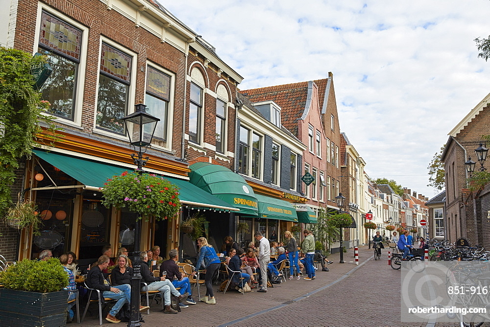 People sitting outside Springhaver Theater in Utrecht, North Holland, The Netherlands, Europe