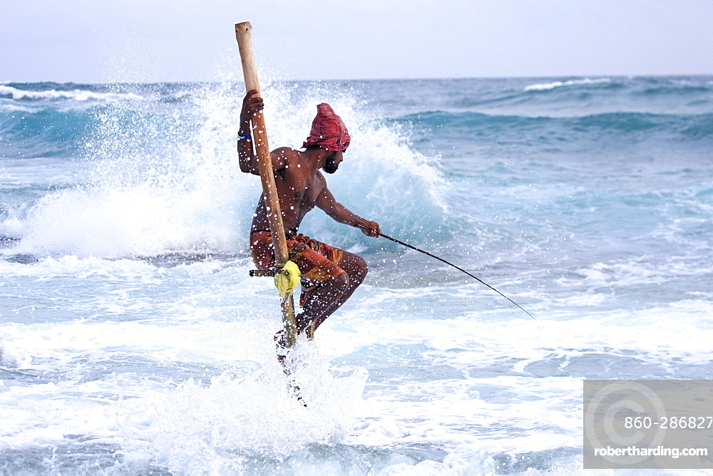 Stilt fisherman near the beach, traditional fishing, Weligama, Indian Ocean, Sri Lanka