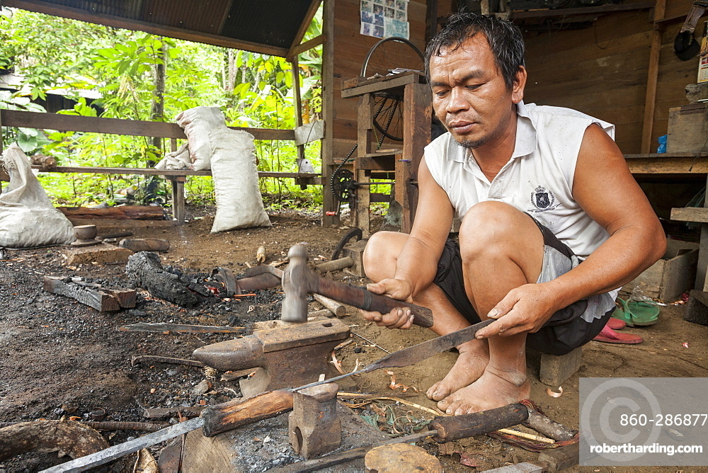 Man forging a traditional Dayak saber - Borneo Indonesia
