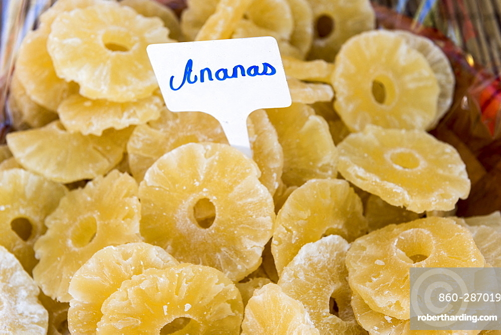 Candied pineapple slices on a market stall, summer, Provence, France