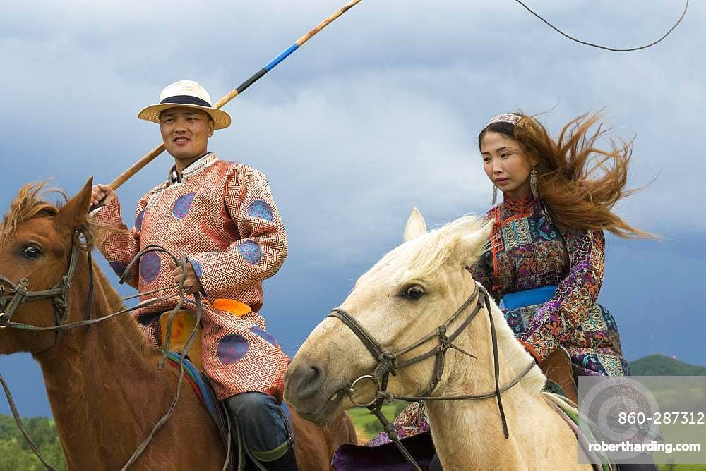 Mongol on a horse, with a catch lasso, Zhangjiakou, Bashang Grassland, Hebei Province, Inner Mongolia, China