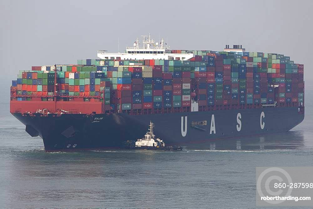 Container ships and tugs, Port Kelang, Malaysia.