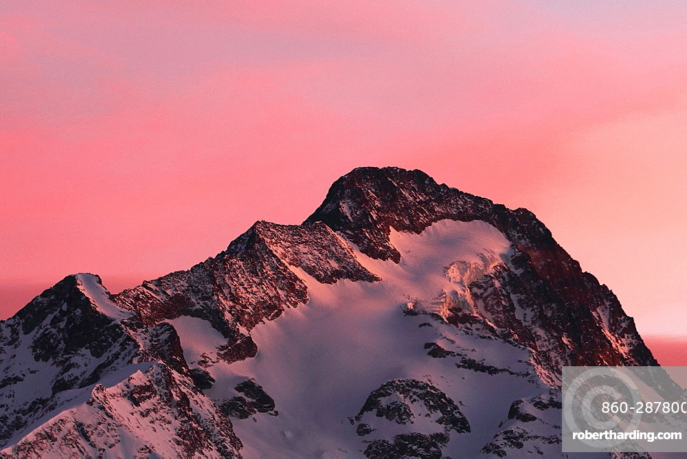 Pic blanc, Moutain in the sun setting in the alps, France