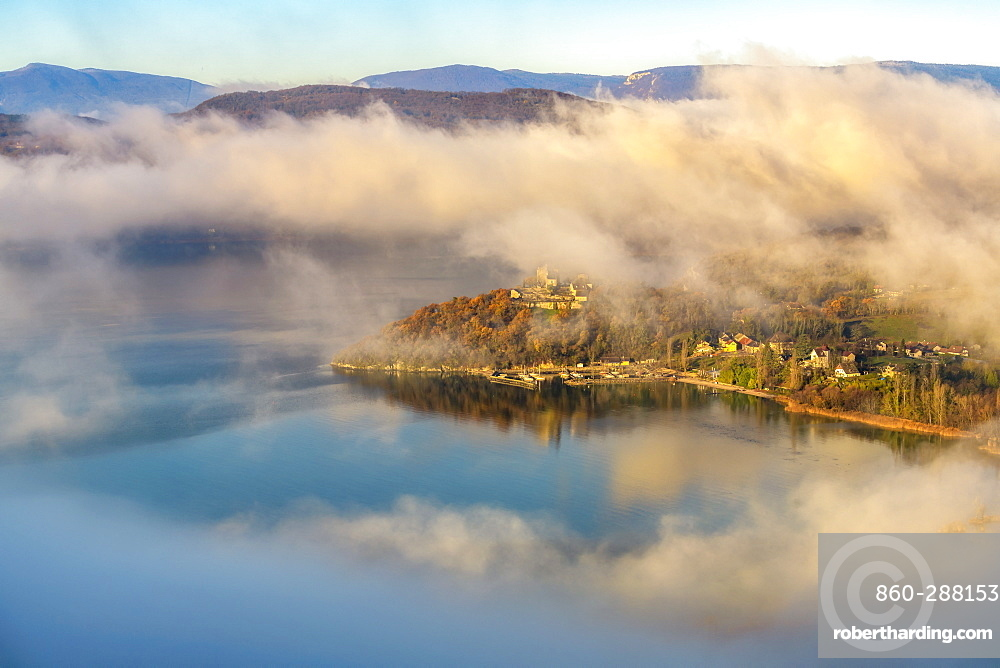 Castle overlooking Chatillon Bay and autumn mists north of Lake Bourget, Savoie, Alps, France