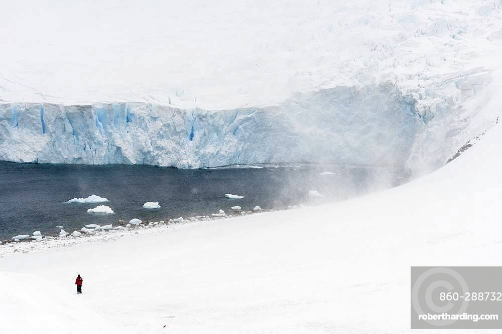 A tourist hiking in Neko Harbour, Antarctica.