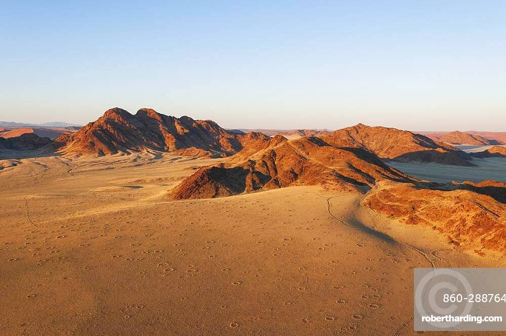 Fairy circles and mountains, Aerial view, Namib Naukluft Park, Namib Desert, Namibia.