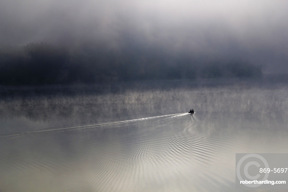 landscape lake and boat in the morning mist at sunrise Thuringia