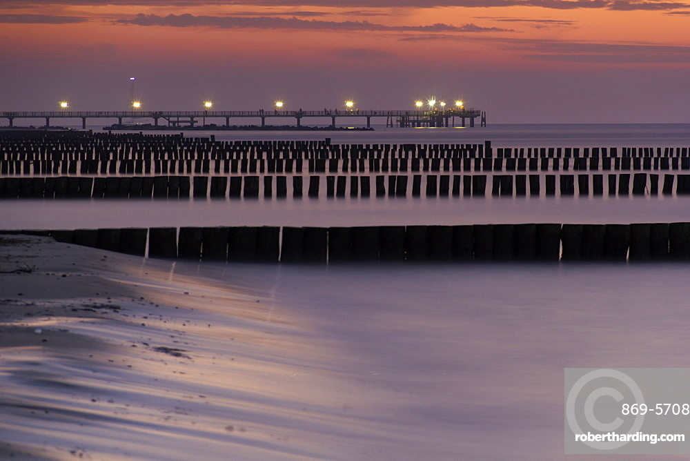coast water sea groynes and pier at sunset Wustrow Peninsula Darvü-Fischland Mecklenburg-Western Pomerania