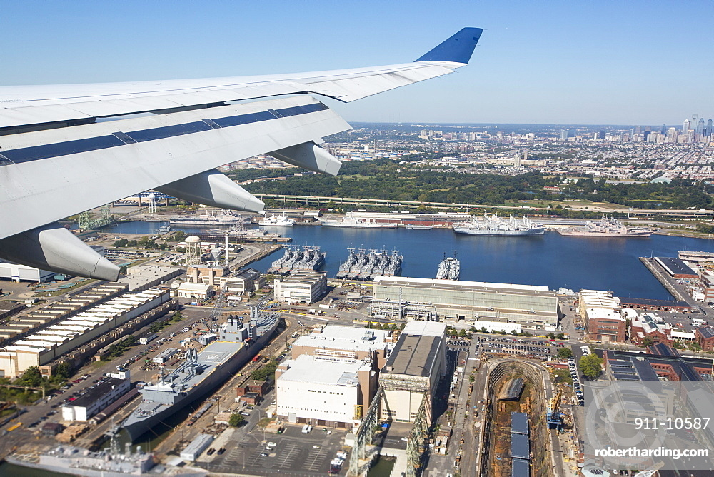 Flying over the Naval Base in Philadelphia, with warships from the American Naval fleet.