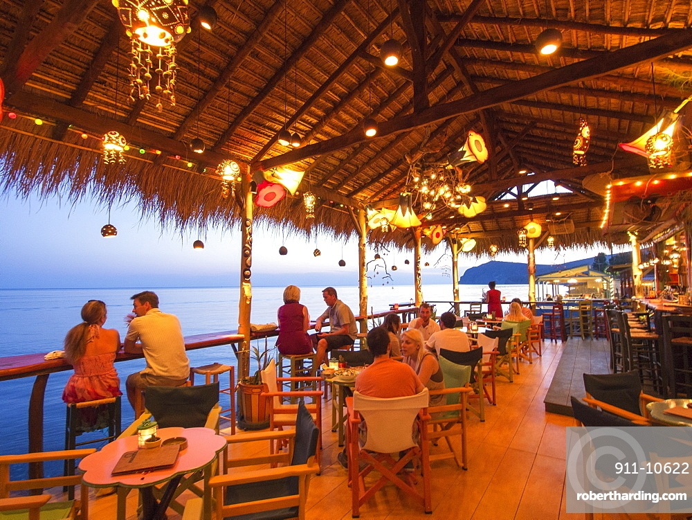 A seafront cocktail bar in Skala Eresou, Lesbos, Greece at sunset.