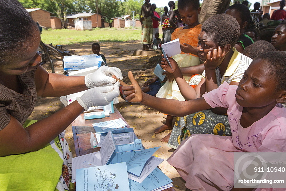 January 2015 saw a three day period of excessive rain which brought unprecedented floods to the small poor African country of Malawi. It displaced nearly quarter of a million people, devastated 64,000 hectares of land, and killed several hundred people. This shot shows A Medicin Sans Frontieres clinic in Makhanga testing local people, many of whom now have malaria, as a result of the drying up flood waters providing ideal breeding grounds for mosquitoes.