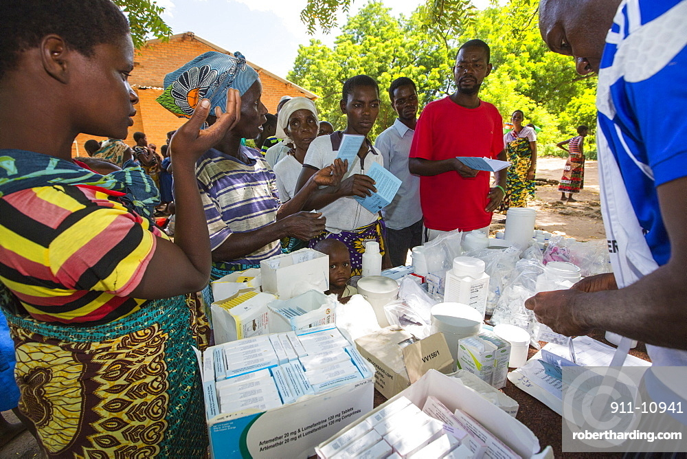 January 2015 saw a three day period of excessive rain which brought unprecedented floods to the small poor African country of Malawi. It displaced nearly quarter of a million people, devastated 64,000 hectares of land, and killed several hundred people. This shot shows A Medicin Sans Frontieres clinic in Makhanga providing Malaria treatment drugs to local people, many of whom now have malaria, as a result of the drying up flood waters providing ideal breeding grounds for mosquitoes.