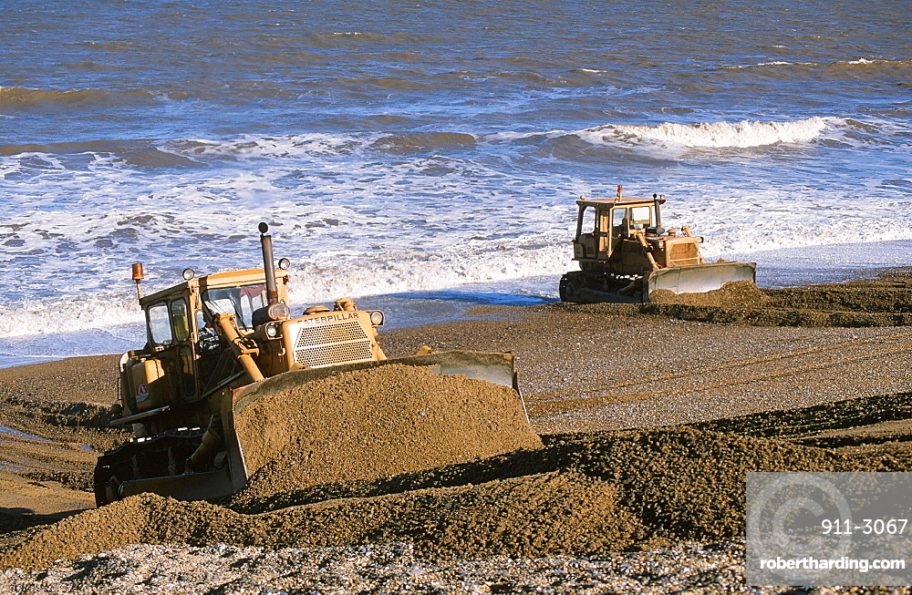 Bulldozers rebuilding the storm beach in Cley, Norfolk, England, United Kingdom, Europe