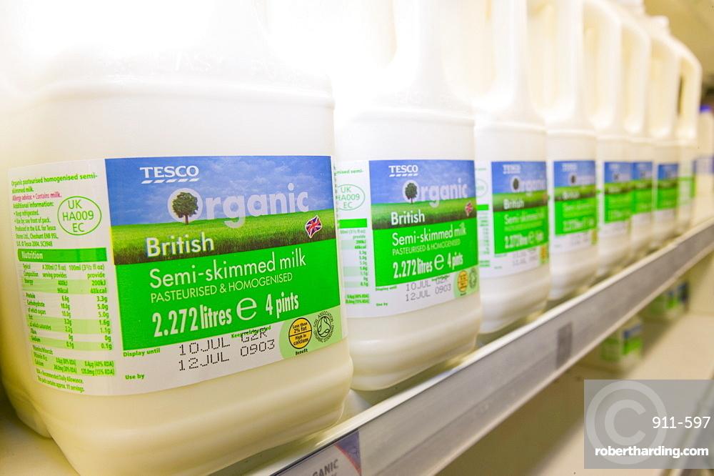Organic milk for sale on supermarket shelves, Cumbria, England, United Kingdom, Europe