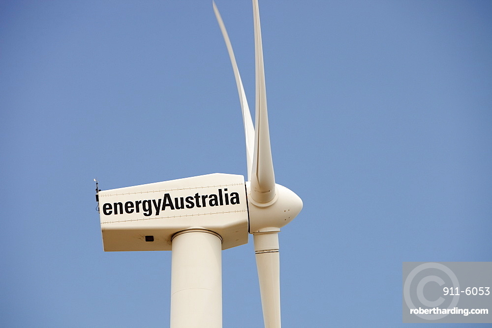 A lone wind turbine stands defiant pointing to a more sustainable future, in Newcastle, the world's largest coal port, New South Wales, Australia, Pacific