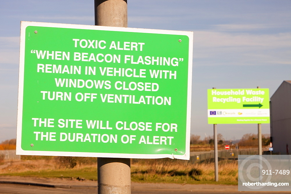 A warning sign about toxic air pollution outside a power from waste incinerator plant at Billingham on Teesside, England, United Kingdom, Europe