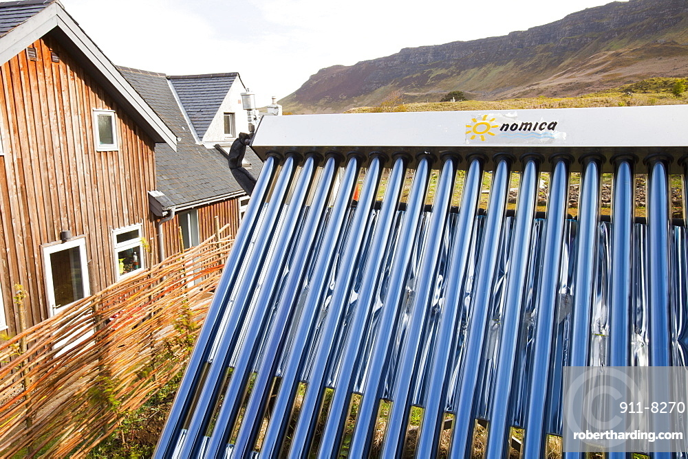 Solar thermal panels on a house on the Isle of Eigg which is 98% powered by renewable energy, west coast, Scotland, United Kingdom, Europe