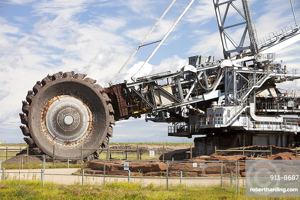 A massive bucket wheel by the Syncrude upgrader plant, Alberta, Canada, North America