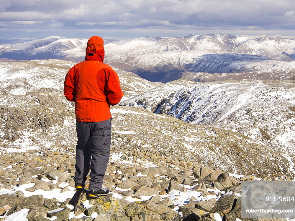 A hill walker on the summit of Scafell Pike, the highest mountain in England, Lake District, Cumbria, England, United Kingdom, Europe