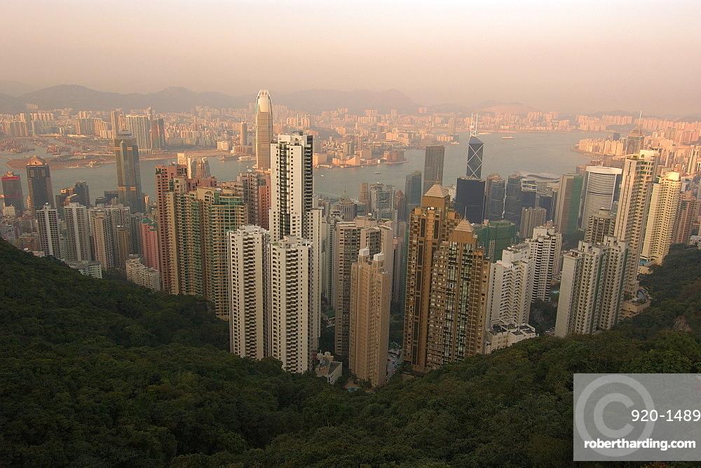 Hong Kong's modern skyline overlooking Victoria harbour and Kowloon peninsula at dusk, Hong Kong, China, Asia