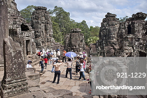 Tourists at The Bayon, Angkor Thom, Angkor, UNESCO World Heritage Site, Siem Reap, Cambodia, Indochina, Southeast Asia, Asia