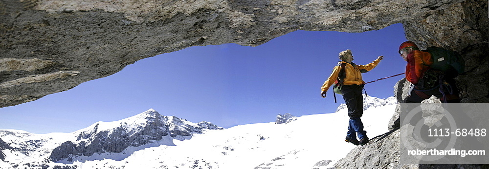 Two mountain climbers in a cave at Schoberl, Hallstaetter Glacier, Dachstein, Austria