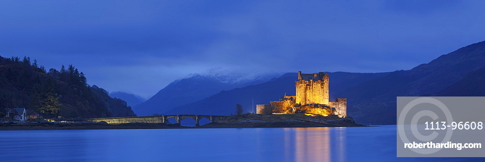 Panorama of the medieval Eilean Donan Castle in Loch Duich with mountains in the background, Dornie, Scotland, United Kingdom