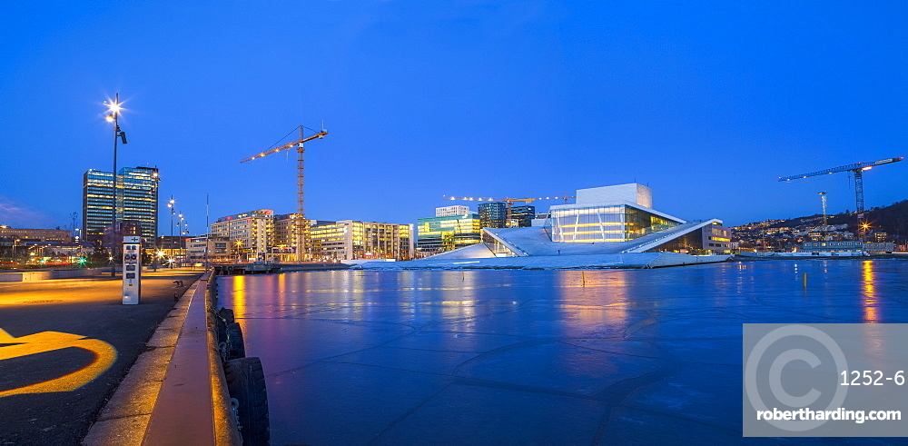 Night panoramic view of the Oslo Opera House, frozen bay and new business quarter, Oslo, Norway, Scandinavia, Europe