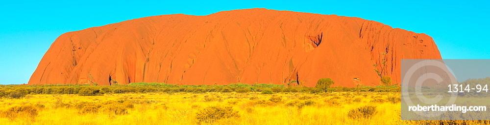 Banner panorama of majestic Uluru (Ayers Rock), the huge sandstone monolith in Uluru-Kata Tjuta National Park, icon of Australian outback or Red Centre, UNESCO World Heritage Site, Northern Territory, Australia, Pacific