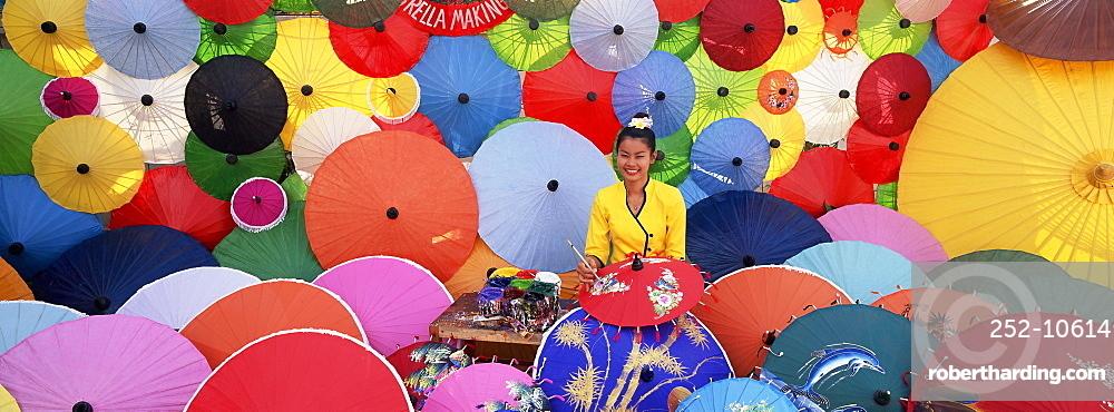 Woman painting umbrellas, umbrella making factory, Bo Sang umbrella village, Bo Sang, Chiang Mai, northern Thailand, Thailand, Southeast Asia, Asia