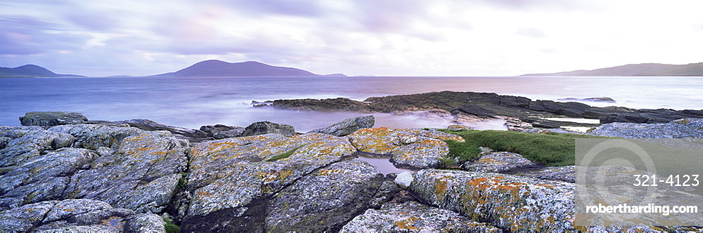 View towards Isle of Harris at twilight, from Paible, Taransay, Outer Hebrides, Scotland, United Kingdom, Europe