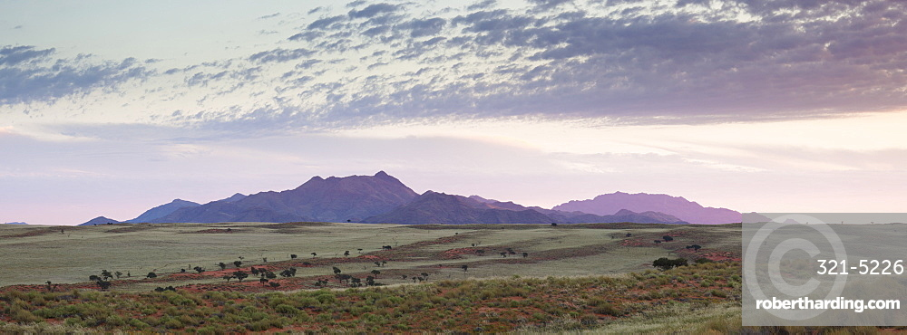 Panoramic view at dusk over the magnificent landscape of the Namib Rand game reserve, Namib Naukluft Park, Namibia, Africa