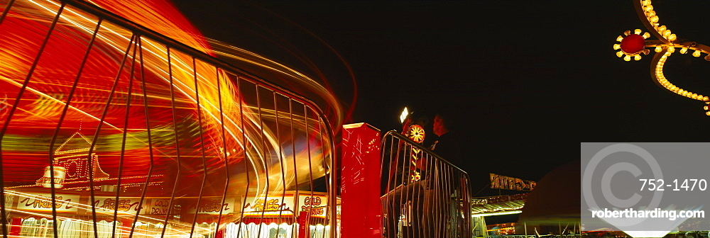 Carousel lit up at night in a carnival, Gloucester, Massachusetts, New England, USA
