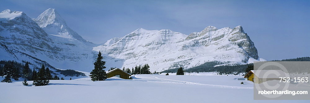 Log cabins on a snow covered landscape, Mt Assiniboine, British Columbia, Canada