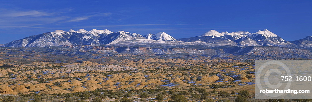 Sand dunes on a landscape, La Sal Mountains, Red Rock Hills, Arches National Park, Utah, USA