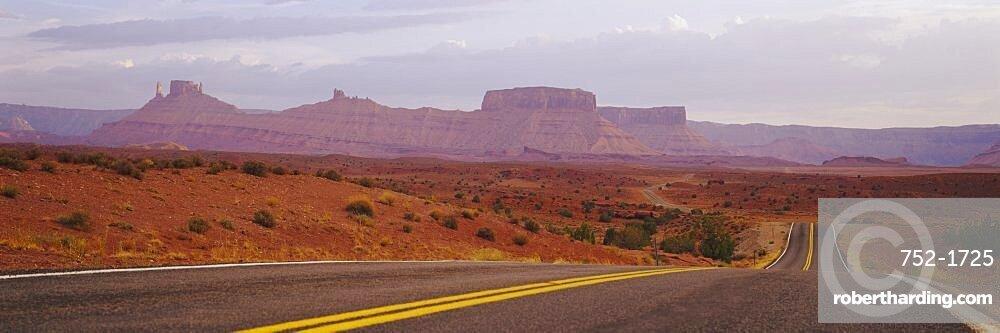 Highway passing through an arid landscape, Monument Valley Tribal Park, Arizona, USA