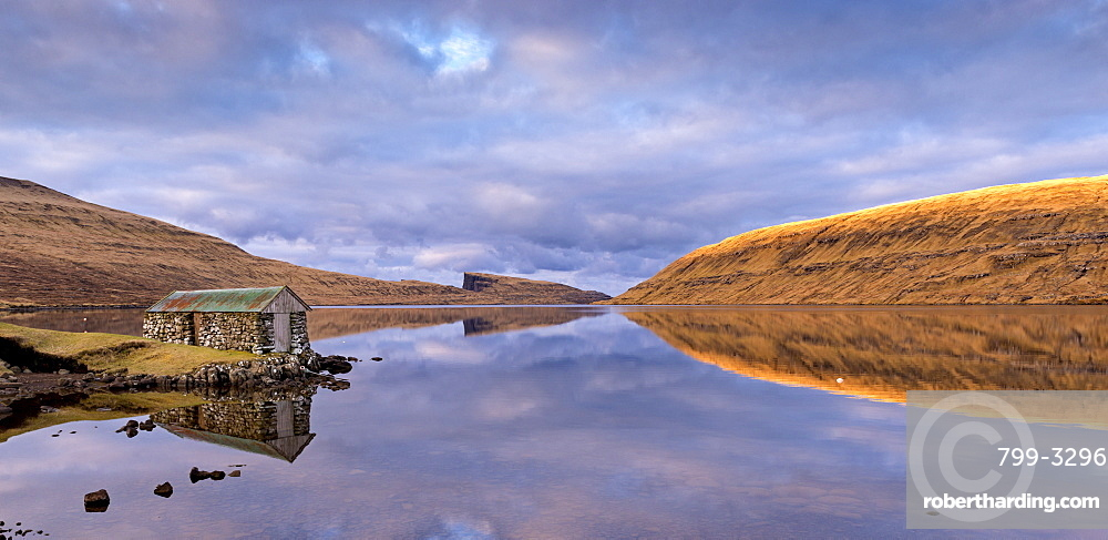 Stone boathouse on the shores of Lake Sorvagur on the island of Vagar, Faroe Islands, Denmark, Europe