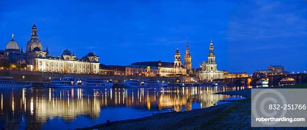 Panoramic city view, Frauenkirche Church, Bruehlsche Terasse, Bruehl's Terrace, Hausmannturm Tower, Hofkirche Church and Semperoper Opera House with reflection in the river Elbe at dusk, Dresden, Saxony, Germany, Europe