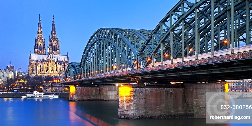 Cologne Cathedral with Hohenzollern Bridge at dusk, Cologne, North Rhine-Westphalia, Germany, Europe