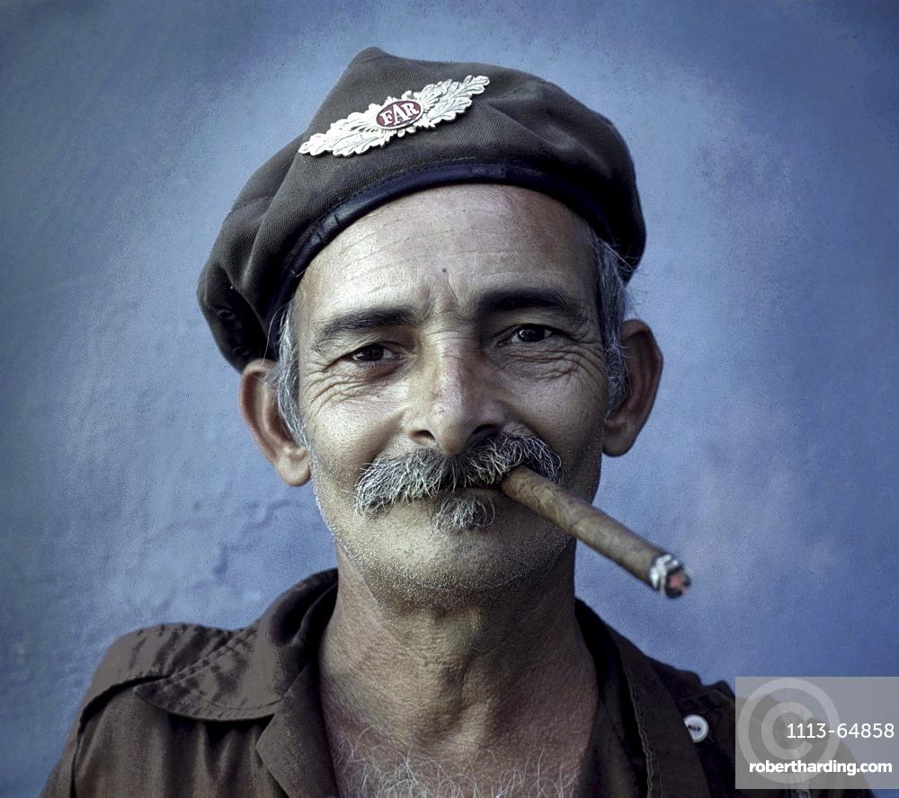 Revolutionist smoking cigar, Havana, Cuba