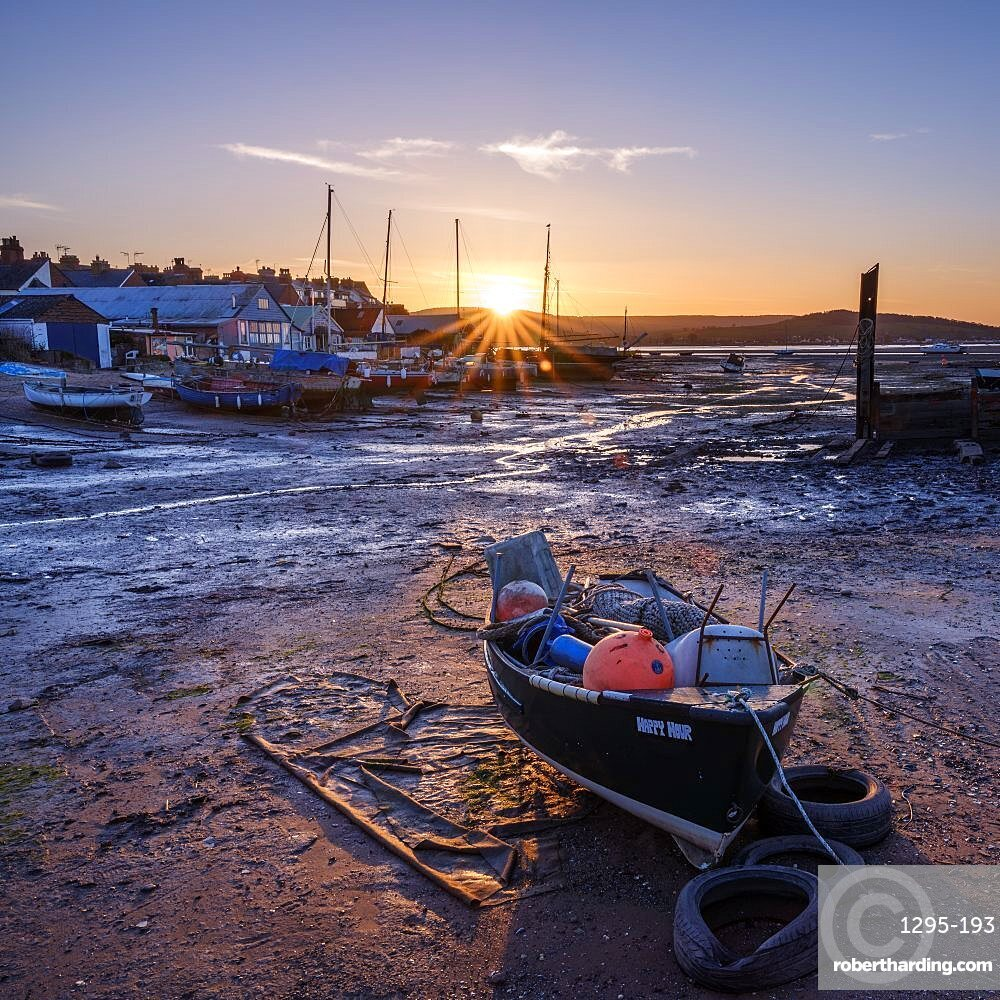 The sun sets behind the boats at Camperdown, Exmouth, Devon , UK