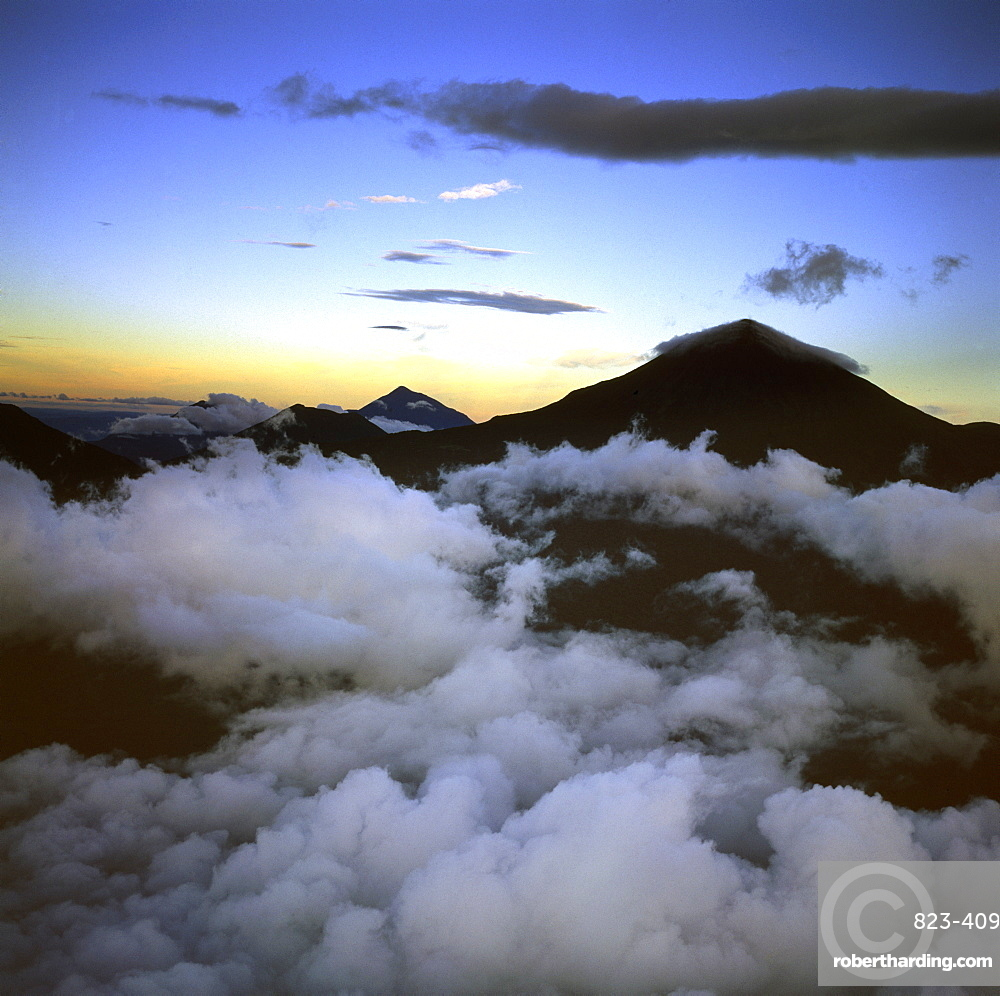Aerial view of Mount Karisimbi, a dormant volcano in the Virunga Mountains on the border between Rwanda and the Democratic Republic of Congo (DRC), flanked by Mount Mikeno to the north, Mount Bisoke to the east and Mount Nyiragongo to the west, Great Rift Valley, Africa