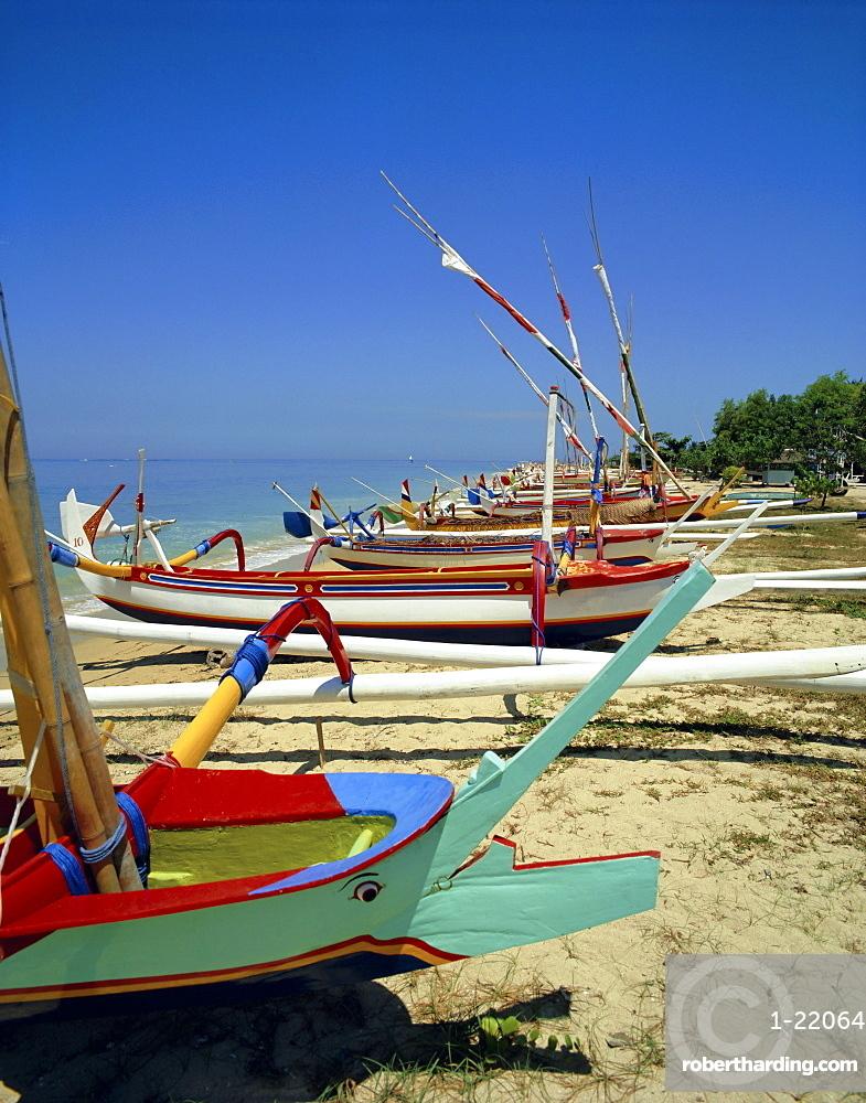 Prahu, colourful local boats, on Sanur beach, Bali, Indonesia
