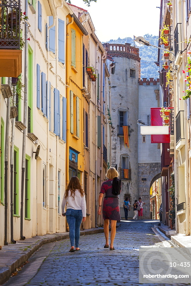 Two women walking towards the old town, Ceret, Vallespir region, Pyrenees, France, Europe