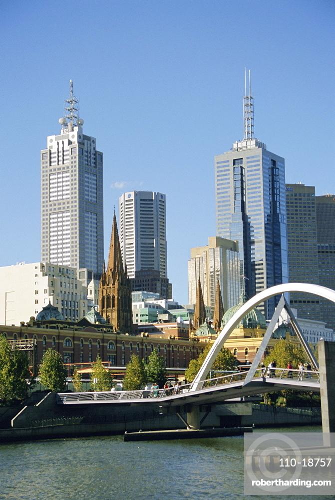 Footbridge over the River Yarra and city skyline, Melbourne, Victoria, Australia