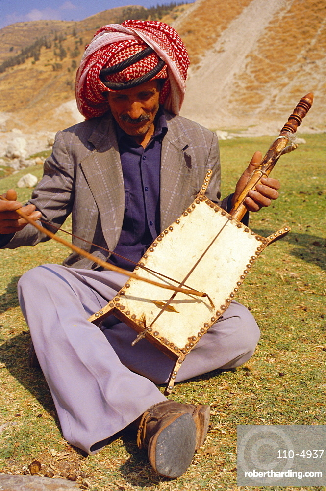 Man playing the rabala, Jordan, Middle East, Africa