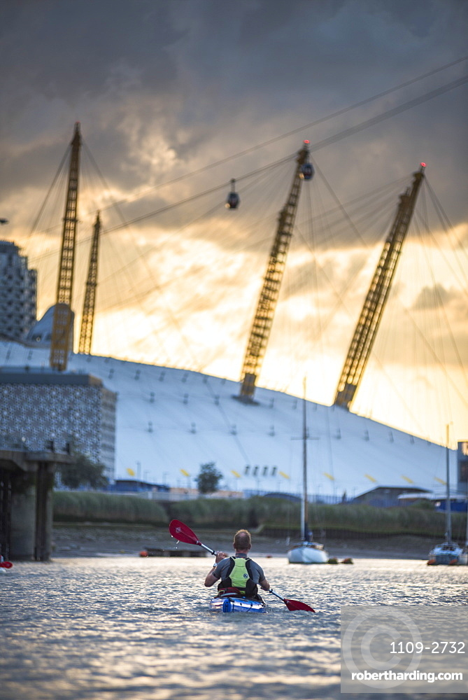 Kayaking on the River Thames at sunset by the O2 Arena, Greenwich, London, England, United Kingdom, Europe
