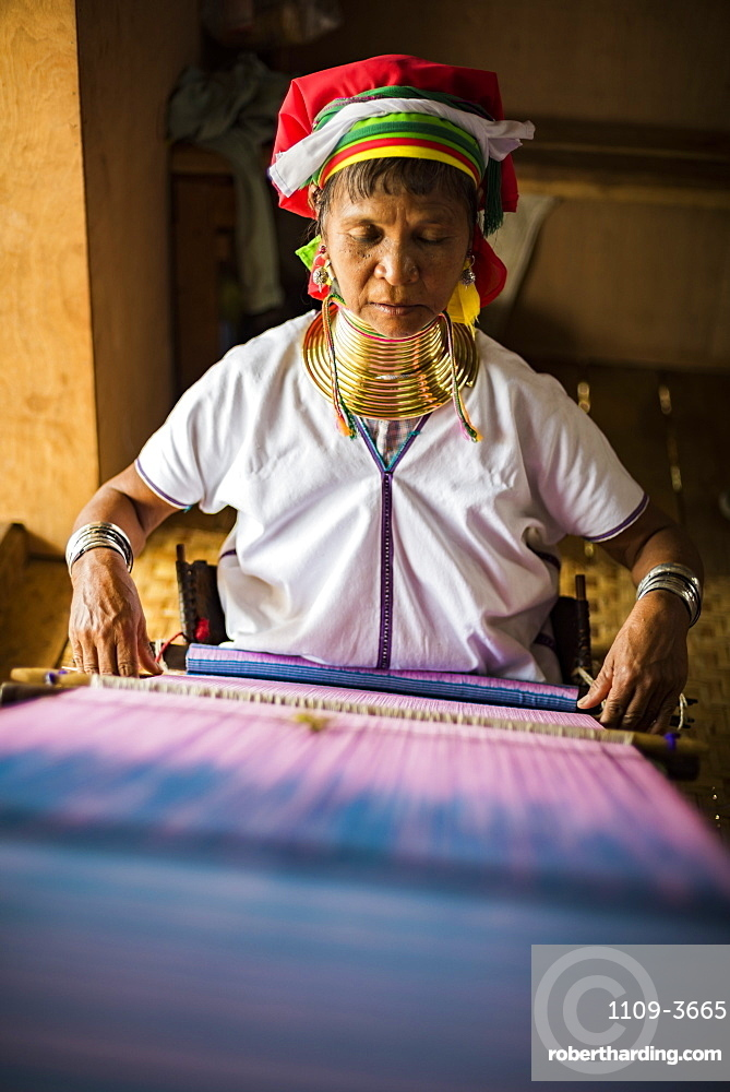 Long necked woman from Padaung tribe weaving at Inle Lake, Shan State, Myanmar (Burma), Asia
