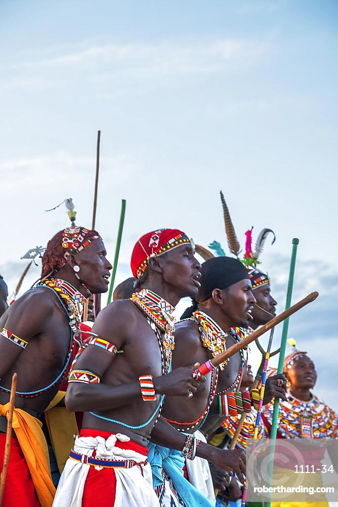 Portrait of Samburu tribe members dancing the traditional wedding dance at dusk, Kenya, East Africa, Africa